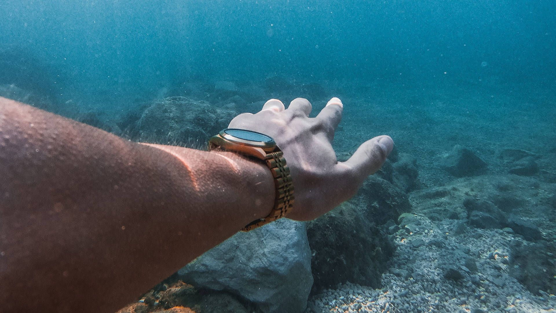 Watch being used underwater after waterproof testing carried out for client in East Kilbride